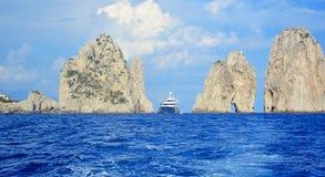 Capri island, Italy. Famous Faraglioni rocks of Capri island in summer stock images