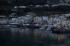 Capri island port at down. The port of Capri island shooted from the ferry. Night scene from ferry-boat. The main building you can see from the port stock photography