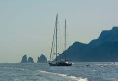 Capri island, silhouette of Faraglioni cliffs Stock Photo