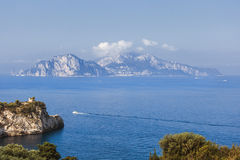 Capri island view from Sorrento coast. Capri island remote view from coast of Sorrento, focus on island and saracen tower on the left stock images