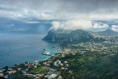 Capri Island view under cloudy sky after storm Stock Image