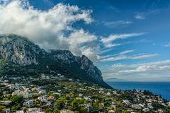 Capri Island view under cloudy sky after storm Stock Images