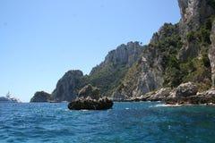 Capri Italy. Capri Island in Italy Europe / Crystal-clear water, boat and enchanting rock Royalty Free Stock Photos