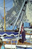 CAPRI, ITALY, 1967 - Among the boats and a crane ship in the port of Capri waves an English flag royalty free stock images