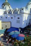 CAPRI, ITALY, 1965 - The domes and vaults of the church of Santo Stefano stand at the top of the stairs of the famous Piazzetta of royalty free stock photo