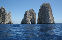 Capri Italy Faraglioni. Enchanting Faraglioni to Capri Italy Europe / Crystal-clear water Stock Image