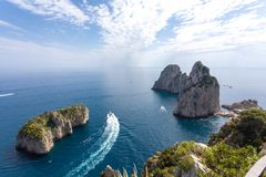 Capri Italy, island in a beautiful summer day, with faraglioni rock emerging from the sea. stock image