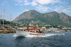 Capri, Italy - a motorboat speeding away from the island royalty free stock photo