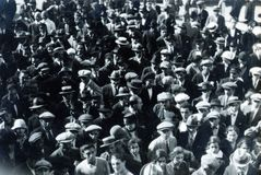 CAPRI, ITALY, NOVEMBER 1, 1926 - Citizens gathered in the square of Capri listen to the news on the attack on Mussolini stock photography