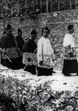 Capri, Italy, 1929 - Some religious parade in cassock with candles during the celebrations of San Costanzo, patron of the island stock photo