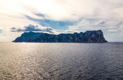 Capri. Italy, Capri, view of the island from the sea in a cloudy sunset royalty free stock image