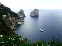 Capri: rocks on the water. The Faraglioni, three rocks in the blue Mediterranean sea near the island of Capri Stock Images