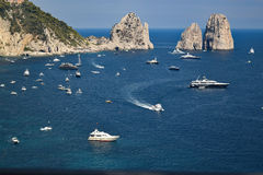 Capri shore with Faraglioni rocks, Italy. Capri shore with Faraglioni rocks and boats. Italy Stock Photos