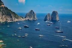 Capri shore with Faraglioni view, Italy. Capri shore with Faraglioni rocks and yachts, Capri Island, Italy Stock Photo
