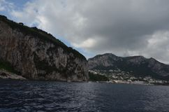 Capri, sky, cloud, sea, coast. Capri is sky, coast and loch. That marvel has cloud, water and highland and that beauty contains sea, cliff and coastal and stock image