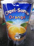 Capri-Sonne juice pouch. Mannheim, Germany - August 24, 2017: Capri Sonne juice pouch. Capri Sun is a brand of juice concentrate drink owned by the German royalty free stock image