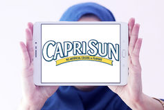 Capri Sun juice drink company logo. Logo of drinks company Capri Sun on samsung tablet holded by arab muslim woman. Capri Sun is a brand of juice concentrate Royalty Free Stock Images