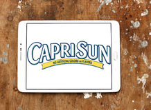 Capri Sun juice drink company logo. Logo of drinks company Capri Sun on samsung tablet on wooden background. Capri Sun is a brand of juice concentrate drink Royalty Free Stock Photo