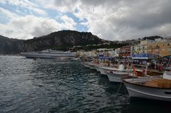 Capri, water, sky, sea, harbor. Capri is water, harbor and loch. That marvel has sky, boat and marina and that beauty contains sea, cloud and reflection. ( stock photos