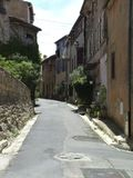 Caprice France. Scenic view of old houses lining hilly street in Caprice village, France. copyspace Stock Image