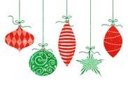 Capricieuze Hangende Kerstmisornamenten Stock Afbeeldingen