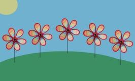 Capricieuze Windmolens op Landschap Stock Foto