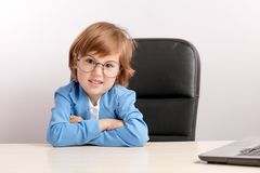 Capricious children. angry little ginger boy is posing to the camera. In the studio. close-up photo stock photo