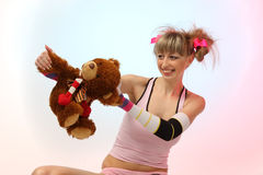 Capricious girl with bear. On the pink background Royalty Free Stock Image