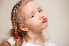 Capricious little girl Stock Photo