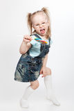 Capricious little girl with lollipop. Capricious little girl with big lollipop stock photography