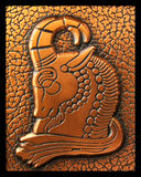 Capricorn. Zodiac symbol carved on copper royalty free stock photos