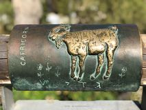Capricorn metal astrological sign on Wishing Bridge in Old City of Yaffa Israel. English and Hebrew capricorn metal astrological sign on Wishing Bridge in Old royalty free stock images