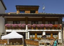 Capriolo bed and breakfast hotel. MADESIMO, ITALY - AUG 21 2014: Capriolo bed and breakfast hotel and restaurant in Madesimo city centre in summer, with flowers Stock Photos