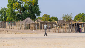 Caprivi, Namibia - August 20, 2016: Poor man walking on the roadside in the rural Caprivi Strip, the most populated region in Nami Stock Photo