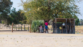 Caprivi, Namibia - August 20, 2016: Poor people working in their village in the rural Caprivi Strip, the most populated region in. Namibia, Africa stock image