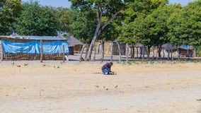 Caprivi, Namibia - August 20, 2016: Poor teenager playing on the roadside in the rural Caprivi Strip, the most populated region in Royalty Free Stock Image