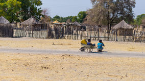 Caprivi, Namibia - August 20, 2016: Poor teenagers walking on the roadside in the rural Caprivi Strip, the most populated region i Royalty Free Stock Photos