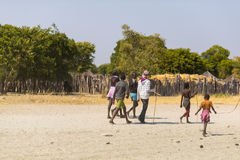 Caprivi, Namibia - August 20, 2016: Poor teenagers walking on the roadside in the rural Caprivi Strip, the most populated region i Royalty Free Stock Photography