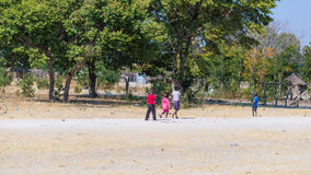 Caprivi, Namibia - August 20, 2016: Poor teenagers walking on the roadside in the rural Caprivi Strip, the most populated region i Stock Photo