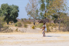 Caprivi, Namibia - August 20, 2016: Poor woman walking on the roadside in the rural Caprivi Strip, the most populated region in Na Stock Image