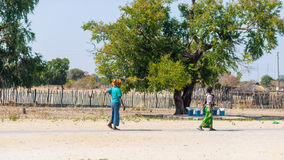 Caprivi, Namibia - August 20, 2016: Poor women walking on the roadside in the rural Caprivi Strip, the most populated region in Na Stock Photography
