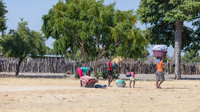 Caprivi, Namibia - August 20, 2016: Poor women walking on the roadside in the rural Caprivi Strip, the most populated region in Na Royalty Free Stock Photos