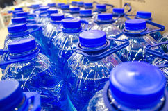 Caps group of blue five liter bottles Stock Photos