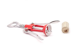 Caps opener. Red opener with an wooden lid Stock Photography