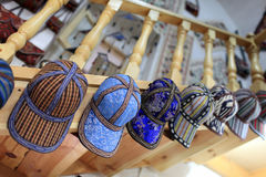 Caps in uzbek store Stock Photography