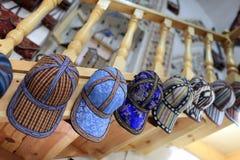 Caps in uzbek store Stock Photography