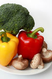 Capsicum, Broccoli and mushrooms. On white plate royalty free stock image