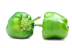 Capsicum love. Two green capsicum isolated on white background royalty free stock photo
