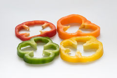 Capsicum or sweet pepper on white background. 4 colors capsicum or sweet pepper slices on white background Stock Photography