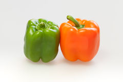 Capsicum or sweet pepper on white background. Green and orange capsicum or sweet pepper on white background Stock Image